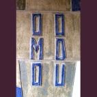 OMO ODU. OMO significa 'Hijo', 'Descendiente', en la lengua Yoruba (Nigeria). ODU es la representación del Universo, del Altísimo o de la Energía Vital del Universo.